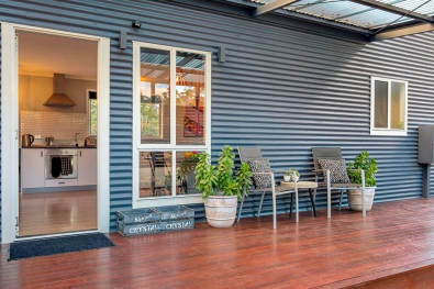Three Beaches Tasmania accommodation industrial country grey corrugated metal facade & seating area