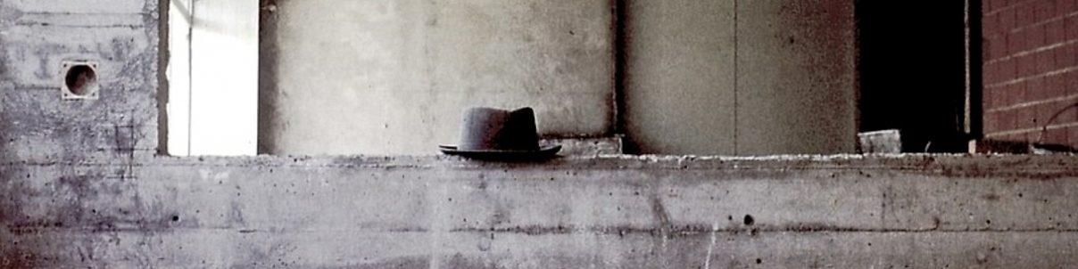 man's hat on building site